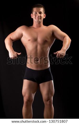 Bodybuilder posing in off season shape #130751807