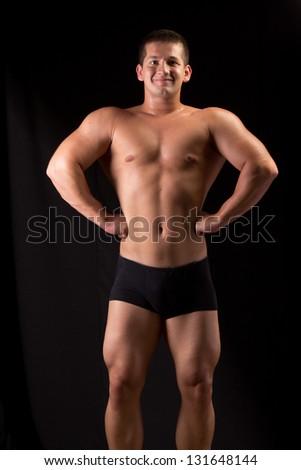 Bodybuilder posing in off season shape #131648144