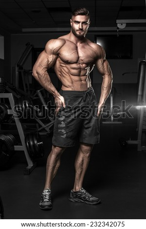 Bodybuilder posing in the gym Stock photo ©