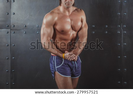 Bodybuilder posing Strong Athletic Man Fitness Model Torso showing big muscles fitness healthy lifestyle bodybuilding concept