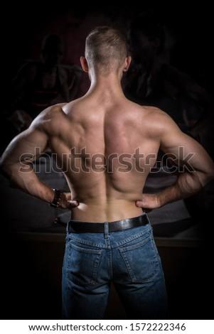 Bodybuilder shows a muscular back