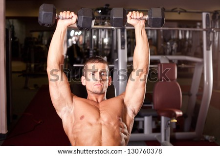 Bodybuilder training in a gym
