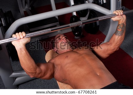 Bodybuilder training in the gym -bench press