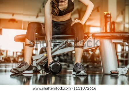 Bodybuilder working out with dumbbell weights at the gym.man bodybuilder doing exercises with dumbbell. Fitness muscular body