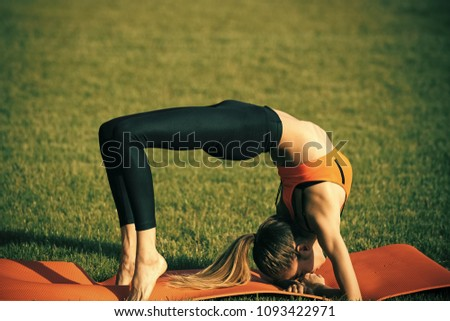 Bodycare woman in crab position on green grass, body care. Bodycare, fitness, wellness, health #1093422971
