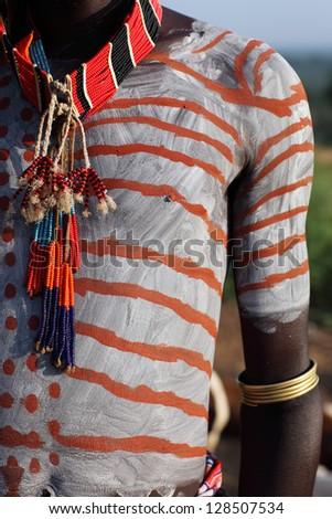 Bodypainting on upper body of Karo warrior, Ethiopia