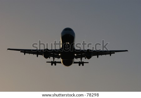 Boeing 767 on final approach at dusk