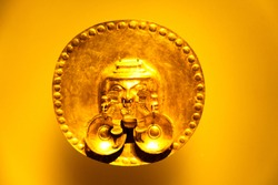 BOGOTA, COLOMBIA - NOV 18, 2019: Gold artifacts on display in the Museo del Oro (Gold Museum).