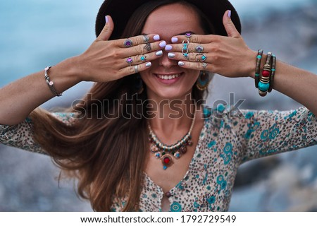 Bohemian chic gypsy smiling happy free woman with manicure wearing hands jewelry accessories, felt hat and dress. Boho detail close up Stock photo ©
