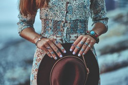 Bohemian chic gypsy woman with manicure wearing jewelry accessories and dress. Boho detail close up