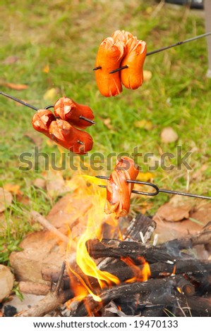 Bohemian sausages cooked over campfire