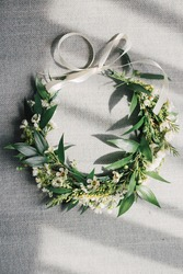 Boho style bride head piece from fresh flowers: white wax flower, goldenrod and ruscus leaves. Bridal greenery crown for a modern rustic wedding. Woman's natural accessory.