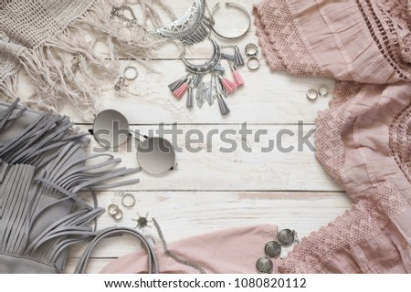 Boho style dusty pink and grey clothes and accessories on white vintage wooden background. Top view point. #1080820112