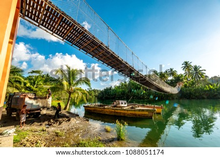 Bohol Island, Philippines : Apr 24,2018 People working by the hanging bridge in loboc river