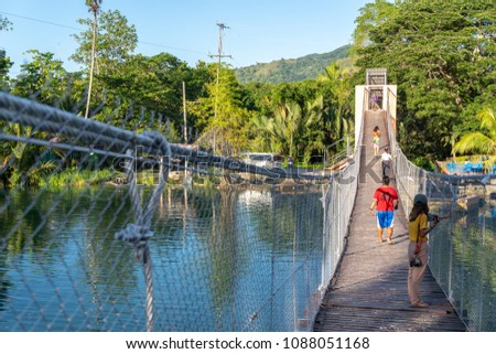 Bohol Island, Philippines : Apr 24,2018 Tourists crossing the hanging bridge at loboc river