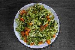 Boiled broccoli and carrots. Isolated on gray or black background. Healthy food.