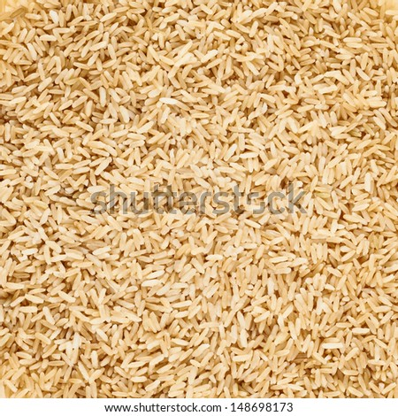 Boiled brown rice as a food background, top close-up view