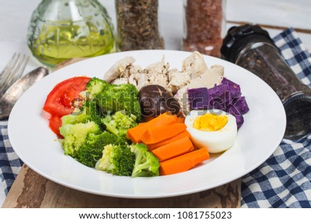 Boiled chicken breasts and vegetables with sports and diet concepts. #1081755023
