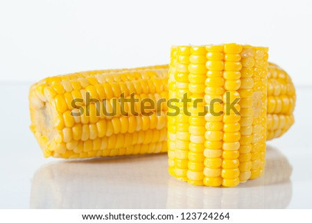 Boiled corn on white background with reflection