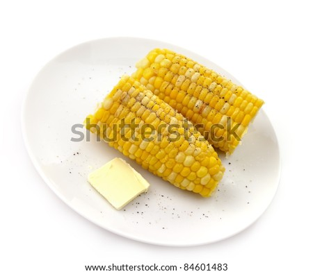 boiled corn with salt and pepper and butter on a plate