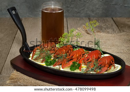 Boiled crabs with lemon, herbs and beer #478099498