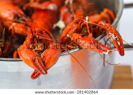 Boiled crayfish in pan on a wooden board, a traditional Russian dish