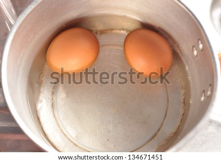 Boiled eggs in a skillet