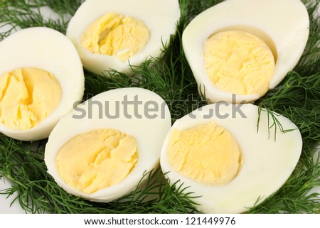 Boiled eggs on color background