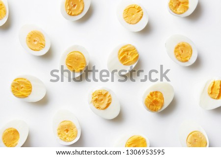 Boiled eggs pattern on a white background viewed from above. Top view. Egg half. Yolk