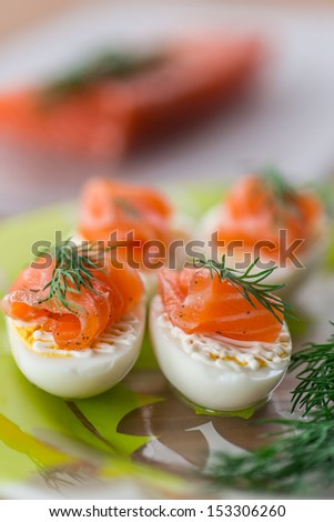 Boiled eggs with salted salmon and herbs