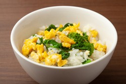 boiled flower of canola and  Scrambled eggs  on  steamed  rice