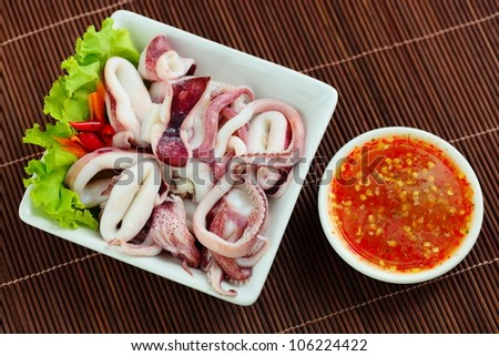 Boiled octopus and sauce. - stock photo