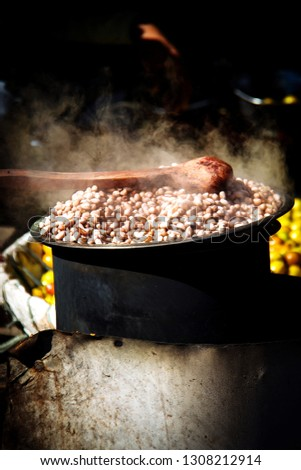 Boiled peanuts/groundnuts are truly delicious, popular as a healthy snacks.peanuts are boiled in hot water and that steame looks beautiful.Its cooked on stove by indian style.creative,abstract, photos