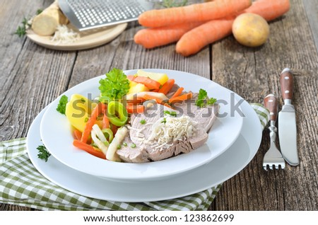 Boiled pork with mixed root vegetables and fresh horseradish - a typical Austrian dish, so-called 'Steirer Wurzelfleisch'