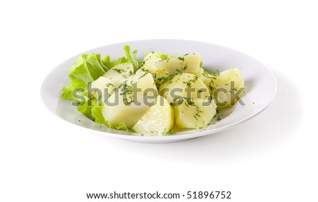 Boiled Potatoes with herbs on white plate