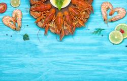 Boiled red crayfish with cold beer. Crayfish on a  blue background.