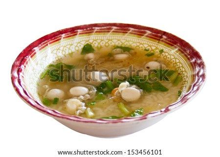 Boiled rice with Scallops place on table