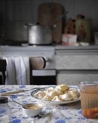 boiled russian pelmeni (dumplings) side view in interior of soviet USSR retro style closeup. Selective focus