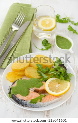 boiled salmon with sauce and potato on the plate