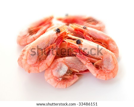 Boiled shrimp on white with shadows.