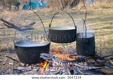boiled water in kettles above the fire