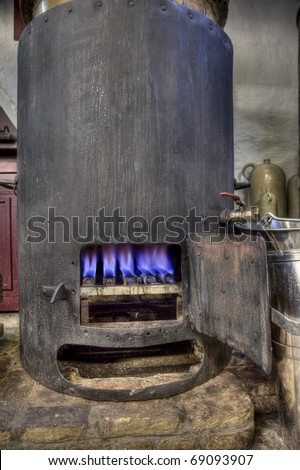 Boiler burning in the distillation process of making gin in a small factory in Dordrecht, Netherlands
