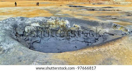 Boiling clay in geothermal area - Namafjall, Iceland - stock photo