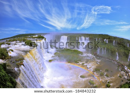 Boiling water foam, crashing and falling jets, a fine mist over the water. The waterfall in the world - Iguazu. The Brazilian side