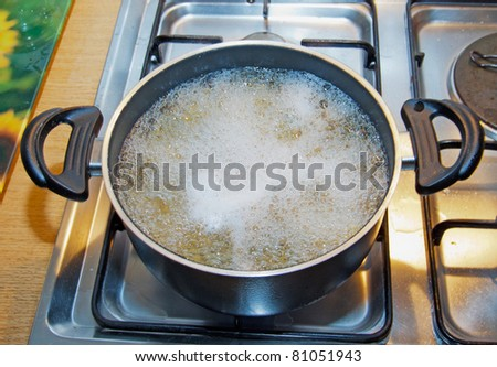 Boiling water inside a kitchen iron pot