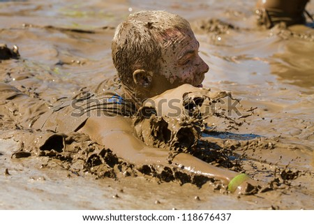 BOISE, IDAHO - AUGUST 25: Unidentified man splashes in the pool at the Dirty Dash August 25 2012 in Boise, Idaho