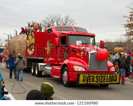 BOISE, IDAHO - NOVEMBER 24: The Famous Idaho Potato Truck moves through the Boise Holiday Parade in Boise, Idaho November 24 2012