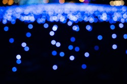bokeh and mysterious brilliance of blue illuminations.