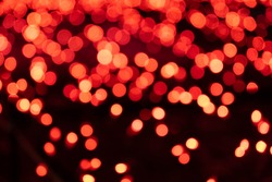 bokeh and mysterious brilliance of red illuminations.