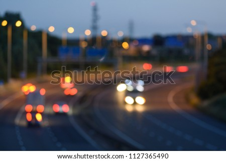 Bokeh background of blurry traffic moving along a UK highway or motorway